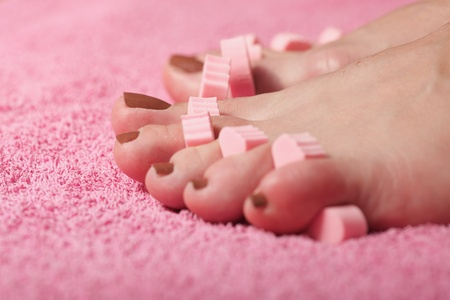 foot pedicure applying pink background Stock Photo - 8564647