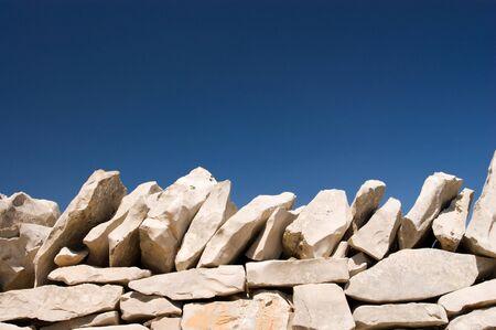 stack stone on blue sky background photo