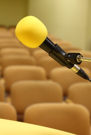 Microphone at conference - rows of empty seats texture  photo