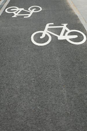 white bicycle road sign black photo