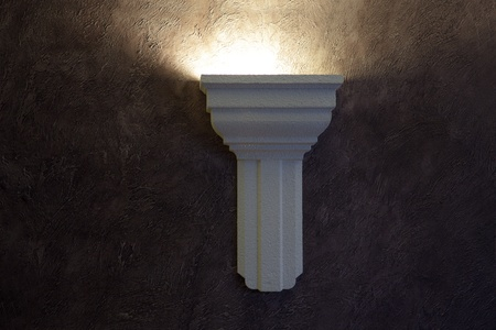 electric lamp on the claret wall in the night time photo