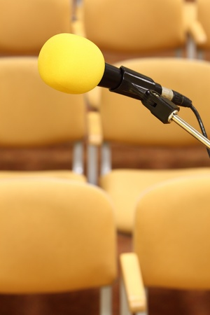 Microphone at conference - rows of empty seats texture  Stock Photo - 9050952