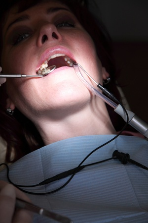 filling: female patient at the dentist doctor