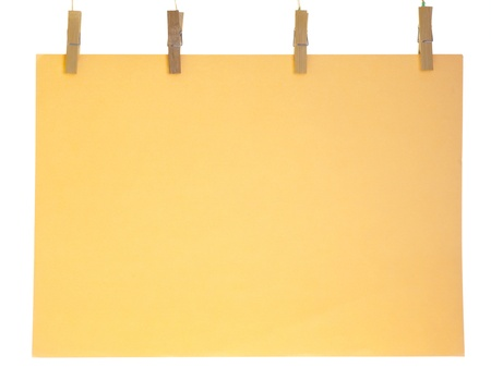 Orange blank paper sheet on a clothes line. Isolated on white background.  photo