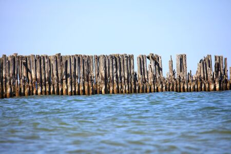 pales: pales of a breakwater - sea and blue sky Stock Photo
