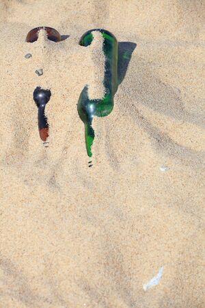 bottle on beach sand - envoronment photo