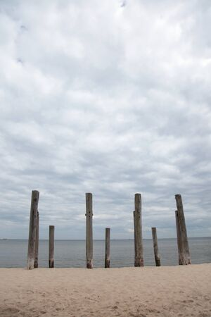 rows of piles on the sea beach - outdoor photo