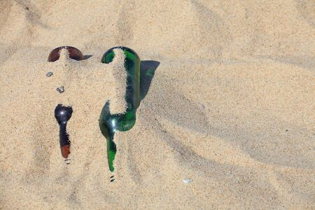 envoronment: bottle on beach sand - envoronment