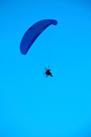 airfoil: Paraglider - Feeling free on the blue sky Stock Photo