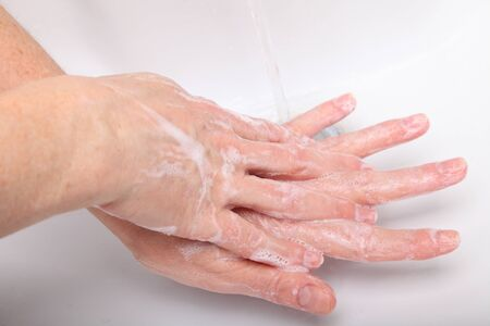 Woman washing sopas hands in bathroom white Stock Photo - 12359940