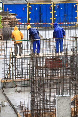 man worker construction building in rain photo