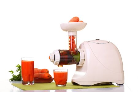 Juice extractor and carrot isolated white kitchen prepare Stock Photo - 12835436