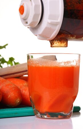 extractor: Juice extractor and carrot isolated white kitchen prepare Stock Photo