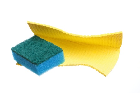Bath sponges blue and yellow isolated on the white background photo