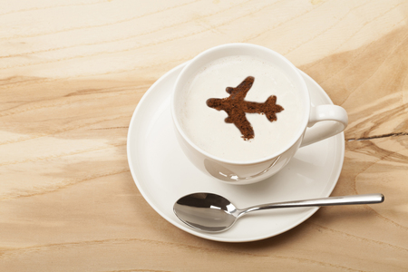 travel by flight on a cup of cofee Reklamní fotografie