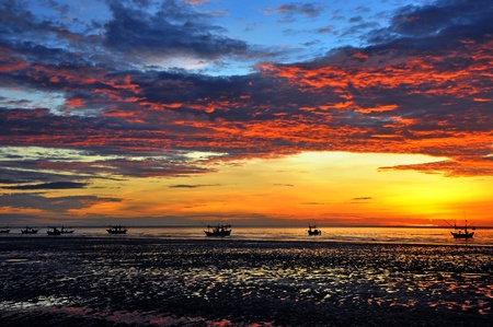 Fishing Boat and Sunrise at Samroiyod Beach, Pranburi  photo