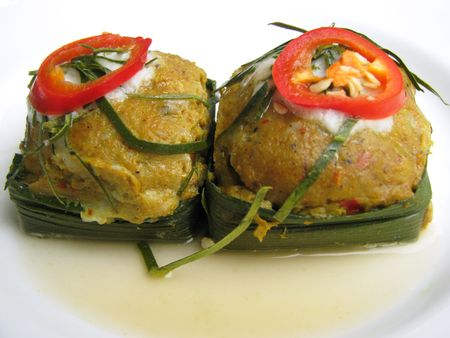 Steamed fish with curry paste is Thai food.
