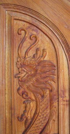 King of Nagas design on brown door of house Stock Photo - 8145076