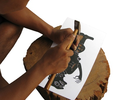 Training make shadow play puppet step that to drive a wedge into paper photo