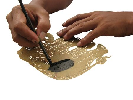 Making shadow play puppet step to coat black color into leather Stock Photo - 8289988