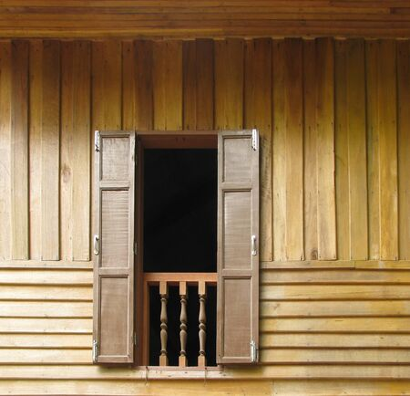 Wood wall and window of thai house Stock Photo - 8311316