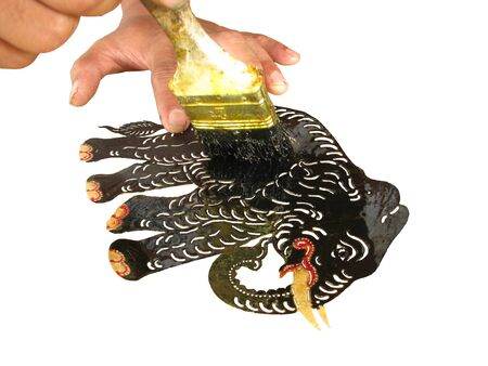 Making shadow play puppet step that to coat a lacquer into leather Stock Photo - 8289986