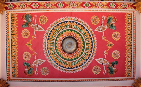Decorated ceiling of temple in the capital of Vientiane, Laos Stock Photo
