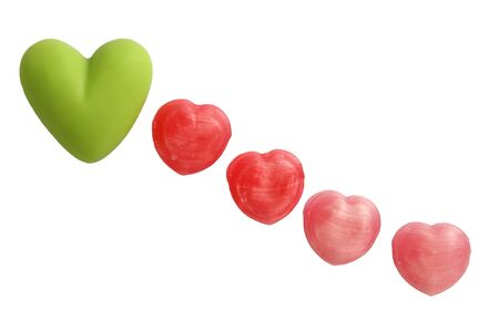 Row down of green and pink sweet candy heart