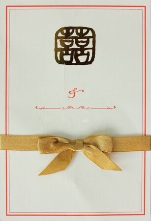 Wedding card with gold bow photo