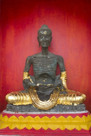 Image of Buddha statue of starving symbol at Thailand Stock Photo
