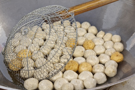 Fish meat ball fry in pan at market of Thailand photo