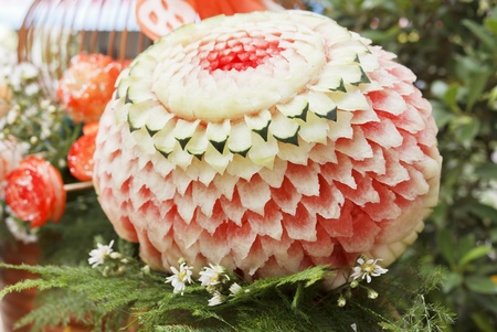 Thai art of watermelon carved into flower shapes photo