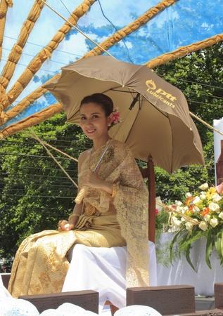 lunar month: NAKHON SI THAMMARAT, THAILAND - SEPTEMBER 26: Woman with Thai dress in Tenth Lunar Month Festival Parade, in Nakhon Si Thammarat, Thailand, SEPTEMBER 26, 2011 Editorial