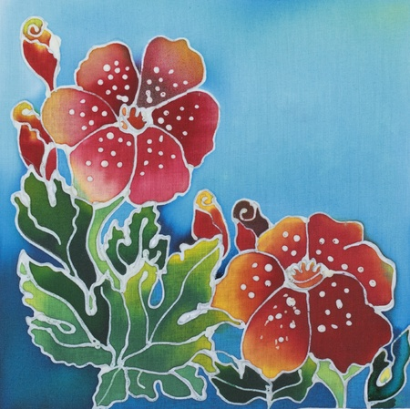 Floral pattern paint on a batik design from Thailand Stock Photo