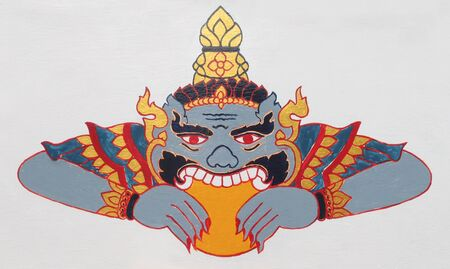 causes: Thai style molding art, giant eating moon or a celestial monster which causes elipses by eating the sun or moon (lunar eclipse) at Thailand temple, Thai culture Stock Photo