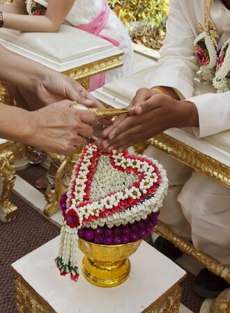 Blessed water at Thai wedding ceremony in Thailand photo