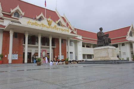allegiance: Nakon Si Thammarat, Thailand - December 02, 2011 : Thai government officer of Nakon Si Thammarat Provincial Court ceremony of taking the oath of allegiance to the King Bhumibol Adulyadej front a picture of the King at Nakon Si Thammarat Provincial Court,
