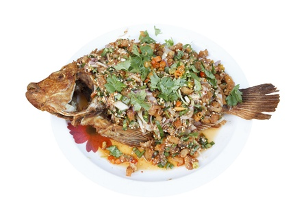 Spicy fried Thai red tilapia fish salad minced meat with vegetable and chilli photo
