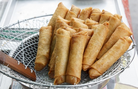 street market: Freshly deep fried spring roll for sale at street market of Thailand