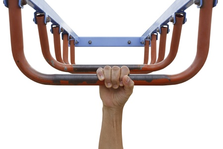 Man hand hanging on monkey bars isolated on white background photo