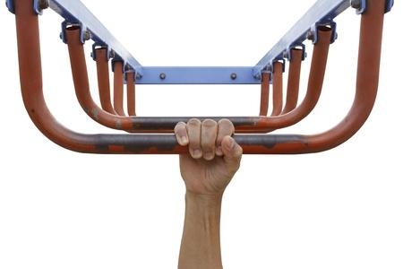 Man hand hanging on monkey bars isolated on white background Stock Photo