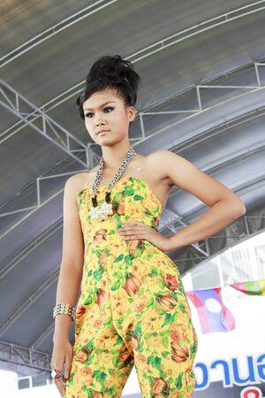 NAKON SI THAMMARAT, THAILAND - FEBRUARY 9: Miss.Jaruwan Chumthong model fashion show at occupational criticism festival, February 9, 2012 in Nakhonsithammarat Vocational College at Nakon Si Thammarat, Thailand.