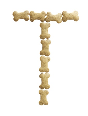 Letter T made of bone shape dog food on white background, shot directly from above photo