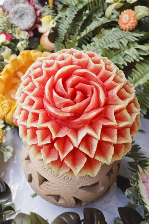 Thai art of carved watermelon like a flower photo