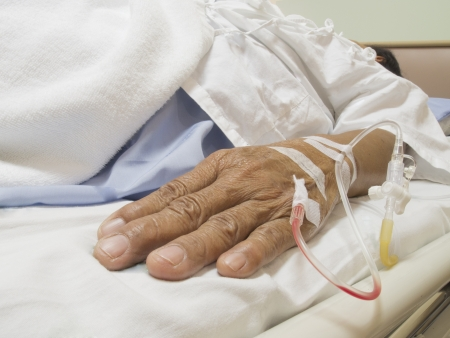 Arm of a female patient in the hospital with an IV