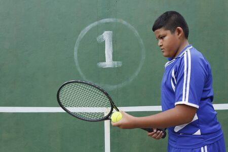 Thai boy tennis player learning how to preparing to play tennis photo