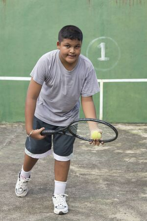 Boy tennis player getting ready to serve photo