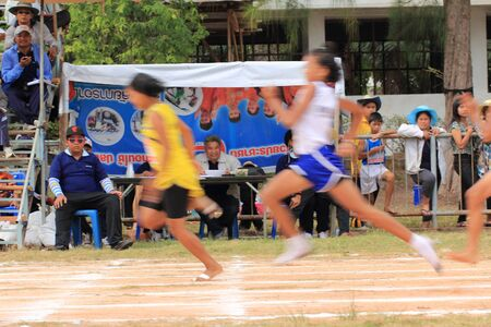 SURATTHANI, THAILND - JULY 27 Unidentified women run at Chiya shcool game on July 27, 2012 in Suratthani, Thailand. Editorial
