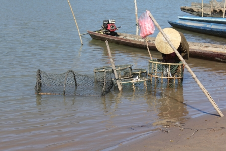 Fisherman hunting fish in river of Laos Stock Photo - 16034151