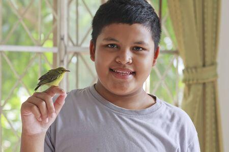 thai boy: Thai boy and baby bird sitting on his finger